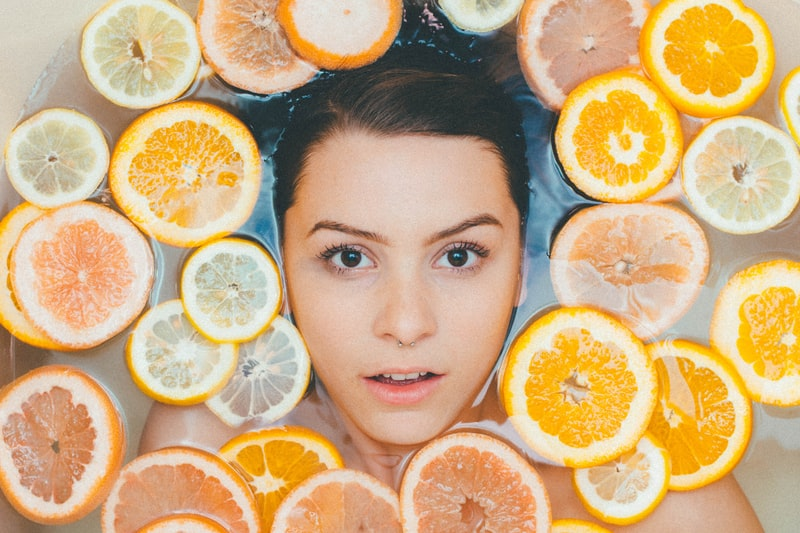 A tray full of oranges on a plate