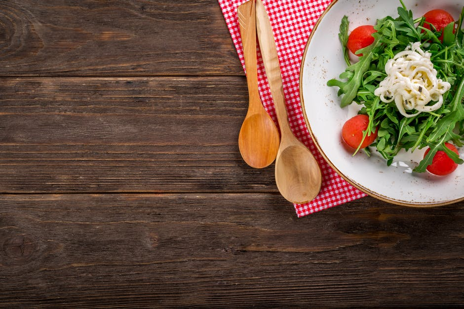 A bowl of food sitting on top of a wooden table